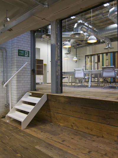 Office pod with bespoke mini white staircase, flooring reclaimed from a church and original white brick tiles