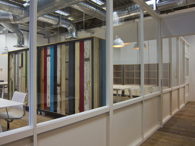 White and glass office partitioning in industrial space