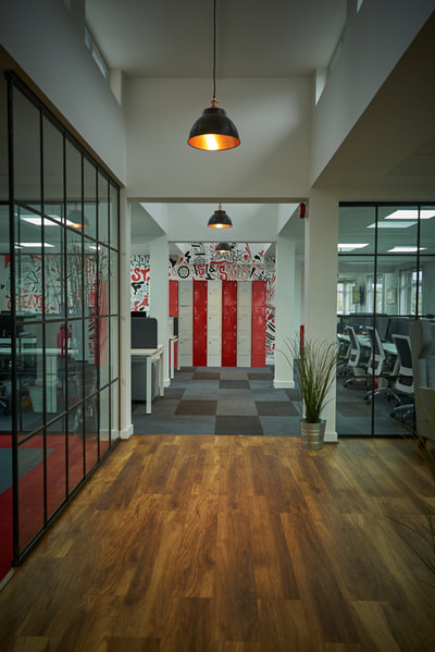 Open plan, recruitment office with critical style glass partition walls and large black pendant lights from Industville