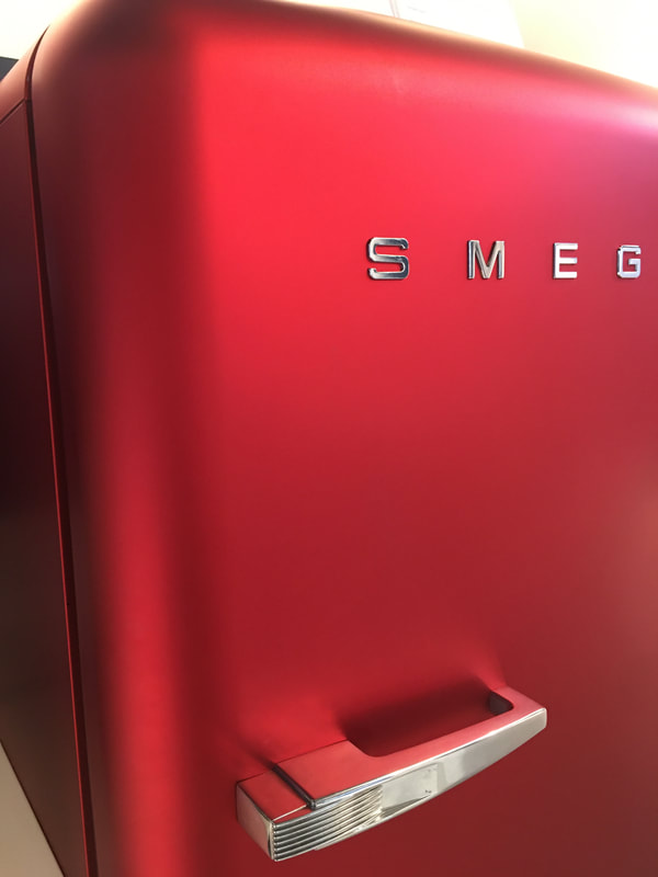 Metallic, red, retro fridge from Smeg